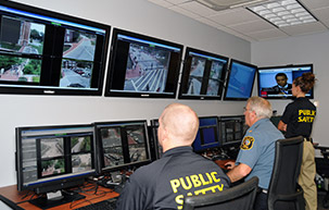 University of Delaware Public Safety officers looking at surveillance monitors