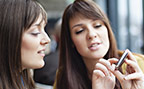 Two young women looking at a smart phone